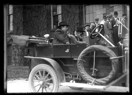 William Jennings Bryan in auto in front of main building