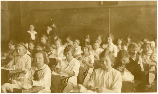 Greendale girls' sewing class. Handwritten on verso, A sewing class at Greendale Consolidated school in Fayette County, Kentucky. (Two copies)