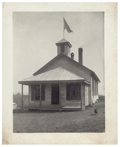 Exterior of the South Elkhorn school house. Handwritten on verso, S. Elkhorn. (Two copies)