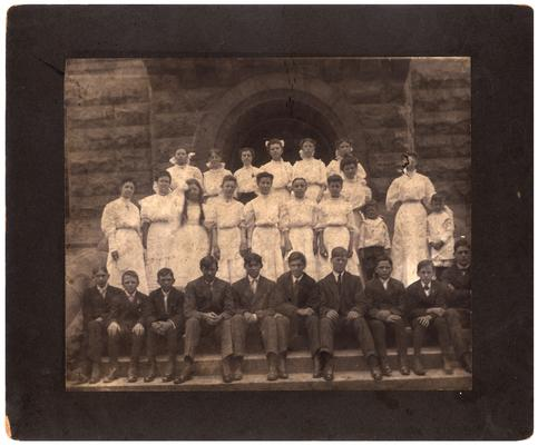 Group portrait of the graduating class of 1906 with Mrs. Nannie Faulconer (1865?-1940)