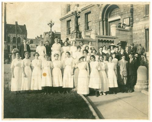 Group portrait of the graduating class of 1918 with Nannie Faulconer (1865?-1940) at the Fayette County Court House. (Two copies)