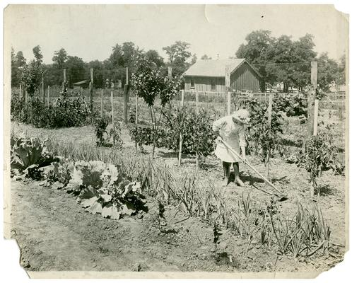 Portrait of an unknown girl tilling up a garden