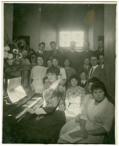 Group portrait of Camillus [Camillus Spain] Sullivan at the piano with other students and Nannie Faulconer (1865?-1940)
