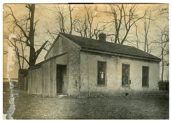 Exterior of an unidentified school house which was abandoned for consolidated schools