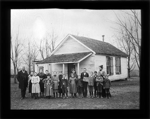 Students outside Maple Grove School on Sandersville Pike with Miss Lula Keith, teacher, and M.A. Cassidy, superintendent of Fayette County Common Schools