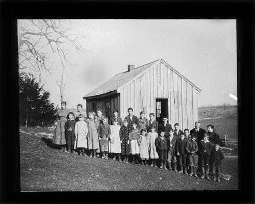 Students outside Jack's Creek School with Miss Maude Spears, teacher