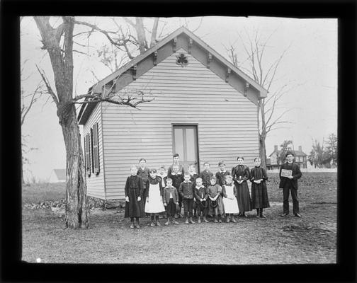 Students outside Parker's Mill School (later called Wolf Run) with Mr. C.S. Sousley, teacher