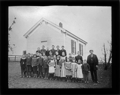 Students outside Briar Hill School with Mr. A.M. Cox, teacher