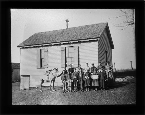 Students outside Hearne School, on Richmond Pike, with Miss Julia Watts, teacher
