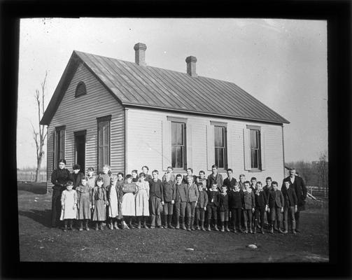 Students outside Mt. Tabor school with Miss Hill, teacher