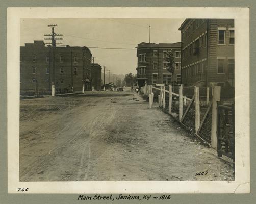 Title handwritten on photograph mounting: Main Street--Jenkins, Kentucky