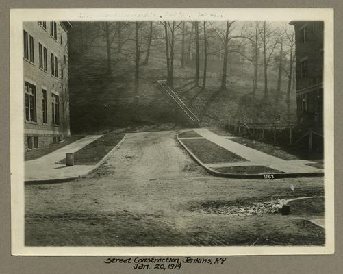 Title handwritten on photograph mounting: Street Construction--Jenkins, Kentucky