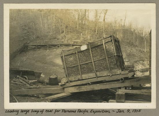 Title handwritten on photograph mounting: Loading large lump of coal for Panama Pacific Exposition