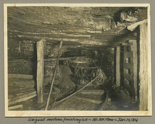 Title handwritten on photograph mounting: Longwall machine finishing cut at No. 204 Mine
