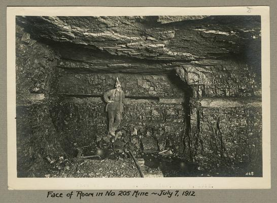 Title handwritten on photograph mounting: Face of room in No. 205 Mine