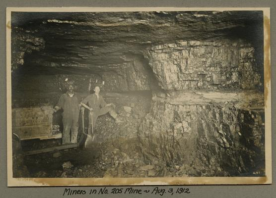 Title handwritten on photograph mounting: Miners in No. 205 Mine