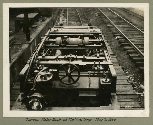 Title handwritten on photograph mounting: Tandem Motor Built at Machine Shop