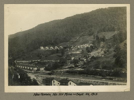 Title handwritten on photograph mounting: New Houses, No. 201 Mine