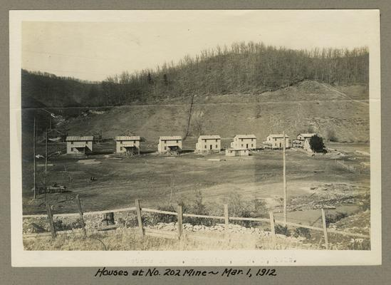 Title handwritten on photograph mounting: Houses at No. 202 Mine