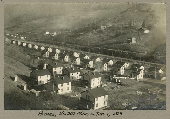 Title handwritten on photograph mounting: Houses, No. 202 Mine