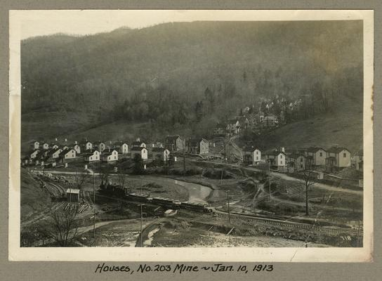 Title handwritten on photograph mounting: Houses, No. 203 Mine