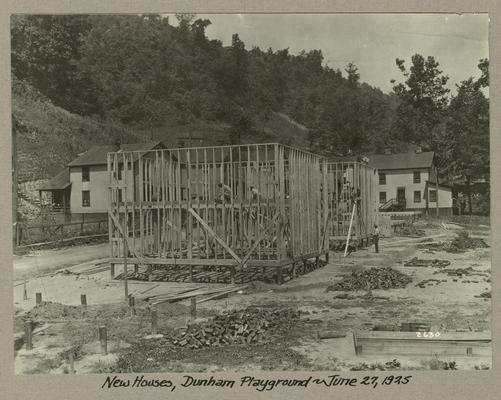 Title handwritten on photograph mounting: New Houses, Dunham Playground