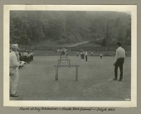 Title handwritten on photograph mounting: Fourth of July Celebration--Hurdle Race (colored)