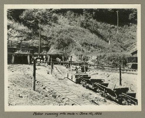 Title handwritten on photograph mounting: Motor running into mule