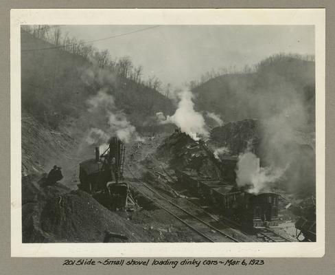 Title handwritten on photograph mounting: 201 Slide--Small shovel loading dinky cars