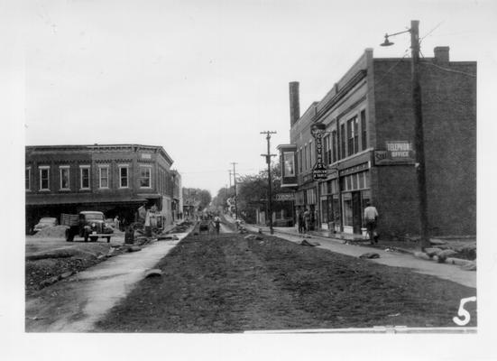 Horse Cave street constructed by WPA, 1941. Marcum and Vance Clothes, and Young's Department store signs in view