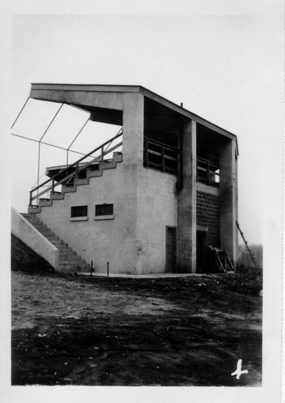 Concrete grandstand at Madisonville City Park. Note concrete arms holding roof