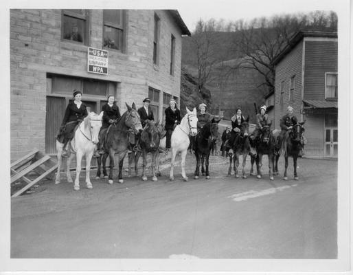 Packhorse Library Carriers mounted on horses outside Packhorse Library in Hindman, Ky