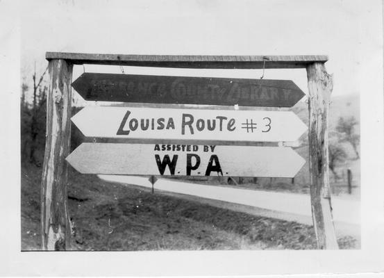 Red, white and blue Packhorse Library sign outside Louisa, 1941