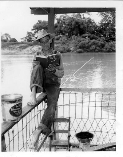 Ferry operator, a regular visitor to the WPA Library, waiting for ferry customers