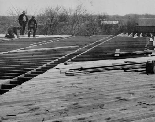 Project #789 District 2: Laying flooring of the new consolidated graded and high school building at Gamaliel, KY. The building containing eight classrooms will be of brick construction and 200 feet by 69 feet in dimension. Brick was manufactured on WPA Project #20 at Gamaliel. Photographed April 4, 1936