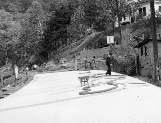 Project #918 District 5: The reconstruction and resurfacing with concrete of five streets in Whitesburg, KY. Completed section of a concrete street. View photographed October 10, 1936