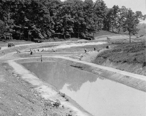 Project #2288 District 5: Project #2288 is for the building of eleven additional fish rearing pools, one lake and 1600 feet of road at the State Fish Hatchery near Ashland, KY. A fish rearing pool photographed July 8, 1936