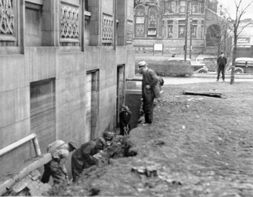 1937 Flood. WPA workers repairing a cave-in on the north side of the Louisville Free Public Library. View was photographed February 8, 1937