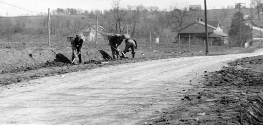 Project #1622 District 6: WPA Project #1622 provides for grading, draining, and surfacing the Scott's Station Road in Shelby County. Workmen are shown dressing shoulders and banks in the photograph, taken March 25, 1936