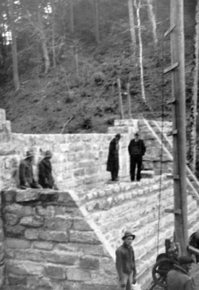 Project #596 District 4: Improvement of the county recreational camp at Watts Creek Settlement, Harlan County, KY. The improvements include repairing stone masonry dam and the construction of a mess hall, a caretaker's cabin, and a recreational hall, all of native materials. View of the reconstructed dam was photographed March 12, 1936