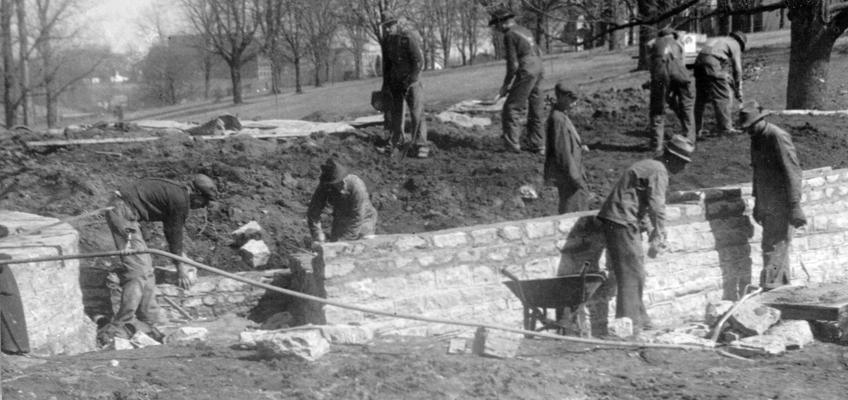 Project #1175 District 4: New Outdoor Amphitheatre for Eastern State Teachers College. Workmen constructing stage of amphitheatre on campus. Photographed February 28, 1936