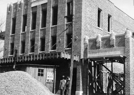 Project #1088 District 1: Construction of a brick and tile City Hall building at Hartford, KY. This structure will contain a community auditorium and a city court room and offices. A one-story annex will house the city fire equipment, with the City Jail in the rear. View of the nearly completed project was photographed April 23, 1936