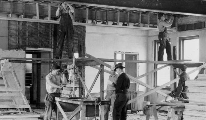 Project #482 District 6: Project #482 provides for the altering and repairing of a three-story brick dormitory for use as an administration, library and classroom building for Negroes of the University of Louisville. The photograph, taken April 6, 1936, shows workmen wiring and installing metal lath
