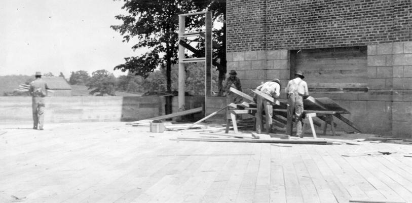 Project #387 District 2: Laying first flooring of the gymnasium-auditorium building of the Edmonton School, which is immediately adjacent to the new structure