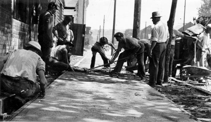 Project #2814 District 3: Construction of streets in the City of Newport, KY. The photograph, taken June 9, 1936, shows construction of a portion of Newport sidewalks