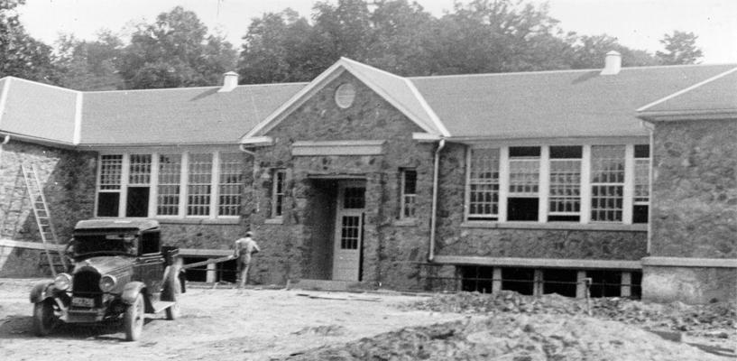 Project #1216 District 4: Ten-room school building in Knox County. Construction of a native sandstone junior high school building at Flat Lick, KY. The front of the new school is shown in the photograph taken July 17, 1936. There are ten classrooms in this building, which is 93' X 128' in dimension