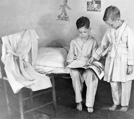 Project #275 District 6: Training Work Center, Louisville, KY. These boys are modeling pajamas and bathrobes made at the Training Work Center. Photograph taken July 29, 1936