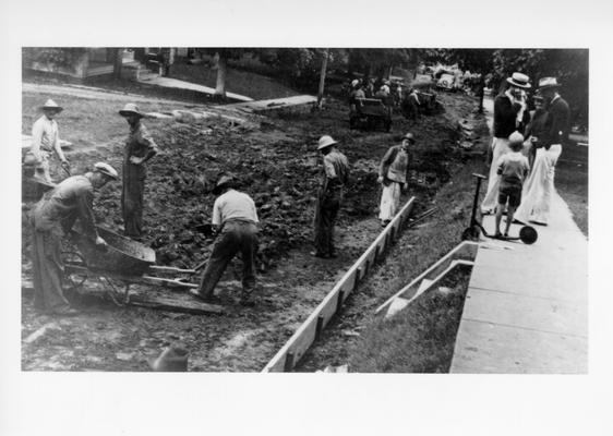 Project #2933 District 1: The improvement of Elsey Avenue from Elm Street to the east city limits in the City of Bardwell was accomplished under Project #365. Other streets, sidewalks and curbs in Bardwell are being built under a new project, #2933. This view, photographed September 29, 1936, shows street excavation work in progress under Project #2933