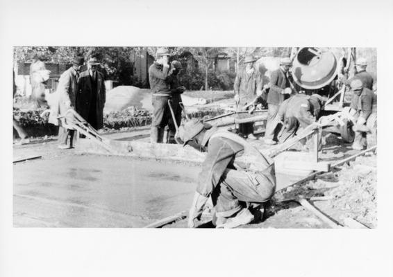 Project #3191 District 3: Improvement of Elizabeth Street in the City of Erlanger, KY. Workers shown finishing a section of concrete pavement on Elizabeth Street. View photographed November 9, 1936