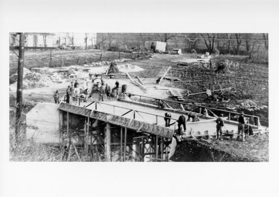 Project #2935 District 3: Farm-to-market road reconstruction in Grant County. Covered by this project is the erection of a bridge, 66' X 16' X 15' on Falson-Elliston Road. This view of the bridge, photographed November 13, 1936, shows workers finishing concrete slab